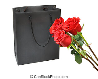 black gift bag with red roses