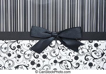 Black gift bow on black seamless pattern