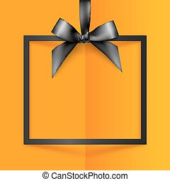 Black gift box frame with silky bow and ribbon on orange folded paper background