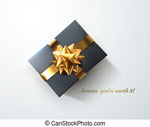 Black gift box with glittering golden bow and ribbons.