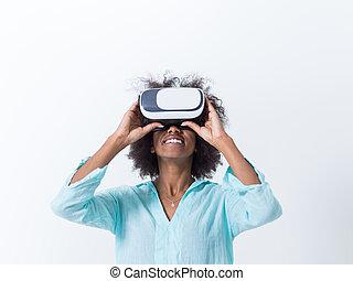 black girl using VR headset glasses of virtual reality -...