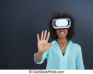 black girl using VR headset isolated on gray background -...