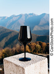 Black glass on the background of beautiful mountains