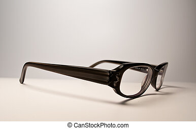 Black glasses over white background