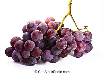 black grapes on a white surface