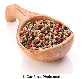 Black, green and pink pepper peppercorn mix in wooden spoon isol