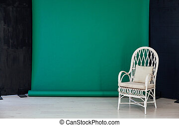 black green background in the interior of the room and a chair
