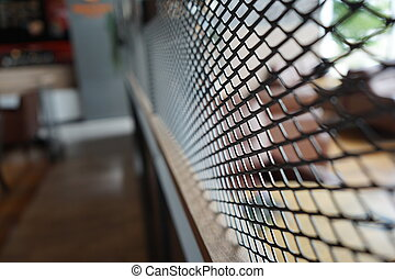 black grill partition with blur background.