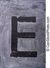 Black grunge alphabet. Letter E