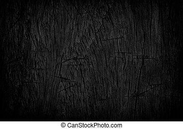 Black grunge texture background. Wood grunge texture on distress wall in the dark. Dark grunge texture background and space. Distress wood black dirty old grain. Black distress wood in dark background