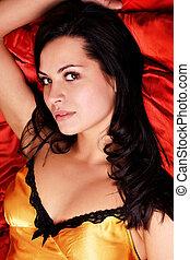 black hair young woman portrait, studio shot