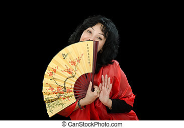 Black-haired woman plays with Japanese fan