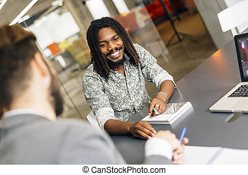 Black handsome employee smiling