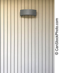 Black hanging lamp on stripe cement wall