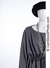 Black hat, grey blouse and jewelry.