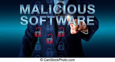 Black Hat Hacker Pressing MALICIOUS SOFTWARE - Black hat...
