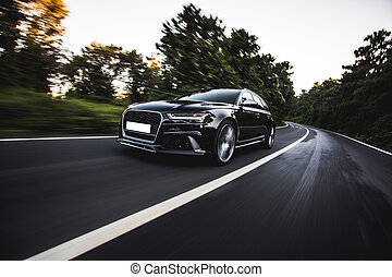 Black hatchback speed drive on the highway