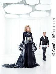 Black haute couture retro futurist couple in modern white...