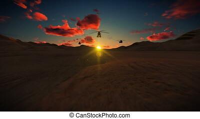 Black Hawk Helicopter crossing dessert against beautiful...