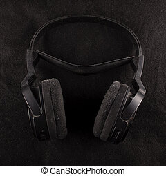 Black Headphones over black background
