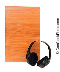 black headphones over wooden background on a white