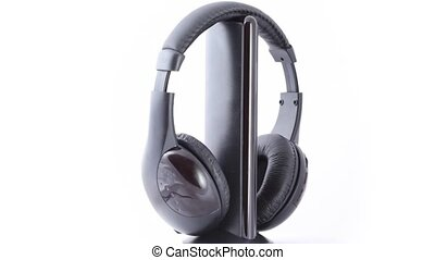 black headphones rotating on white background