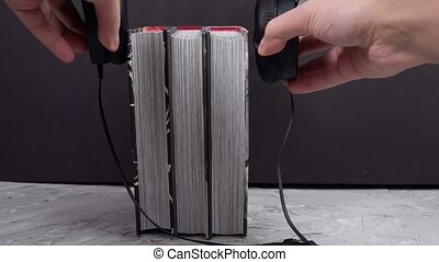 Modern headphones with book. Space for text. audiobooks, modern education