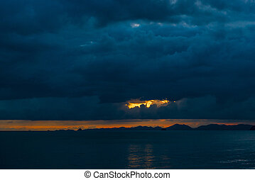 black heavy blue clouds over the sea after sunset, Thailand resort