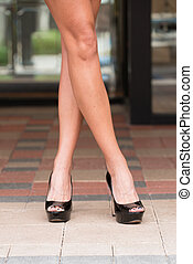 Black High Heels on Paver Block