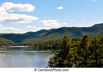 Black hills and water background