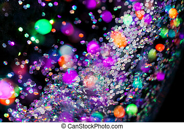 black holiday festival background with colorful lights and confetti.