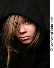 Black hood - Portrait of the young girl in a black hood