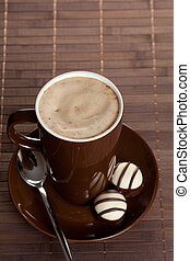 Black hot coffee cup on table
