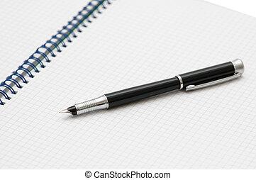 Black ink pen on the spiral book