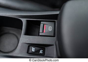 Black interior of a modern car, switch on the electrically assisted parking brake, handbrake.