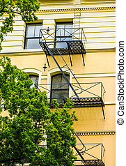 Black Iron Fire Escape on Yellow Building