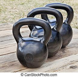 black iron kettlebells - three black iron kettlebell for...
