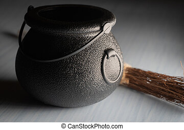 Black iron old cauldron scary prop for halloween used by witches to make brew, potions and poisons. Shows a perfect decoration or image for the upcoming all hallows eve festival