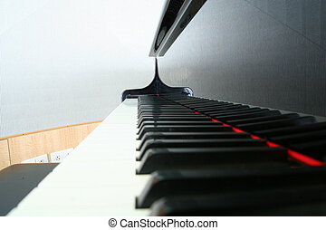 Black Keys Reflection - Closeup of a piano keyboard with...