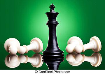 black king defeates white pawns - on green background