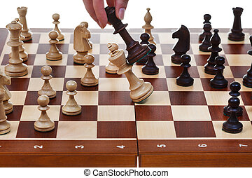 black king drops white king in chess game