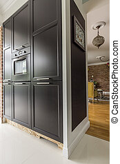 Black kitchen cabinet with cooker