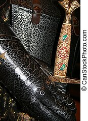 Black Knight - closeup of a black suite of armor holding an...