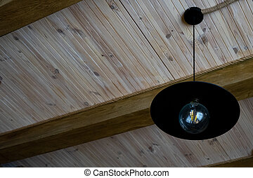 Black lamp in vintage style. Stylish lamp in an ancient wooden interior