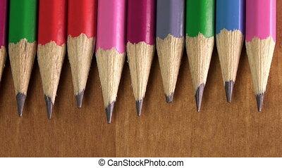 black lead pencils lie in a row ,