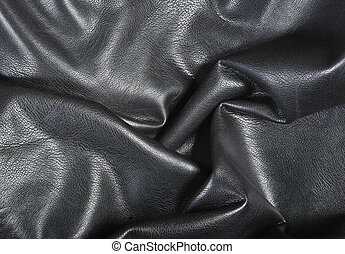 Black leather background with folds