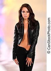 Black leather - Beautiful slender brunette in black leather