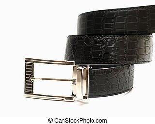 Black leather belt with snake pattern and twirled like a snake on white background