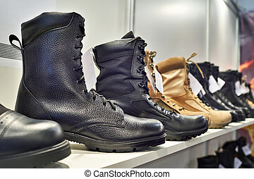 Black leather boots on shelf in store
