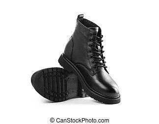 Black leather boots with laces. Close up. Isolated on a white background